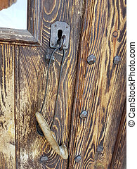 Handles of an old solid wood door