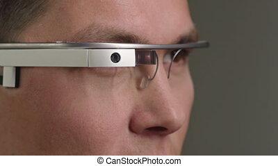 Handling the Futuristic Eyewear - Sided close up of...
