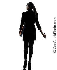 handlowa kobieta, dzierżawa falcownicy, akta, odejście, sylwetka