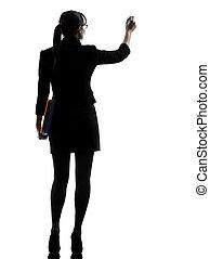 handlowa kobieta, pisanie, dzierżawa falcownicy, sylwetka