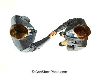 handlowy zaludniają, potrząsające ręki