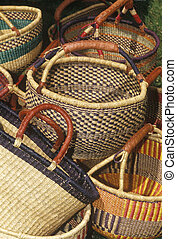 Multiple handmade baskets of various design