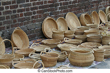 handmade baskets on display by sidewalk vendor