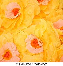 Handmade big yellow paper flowers background