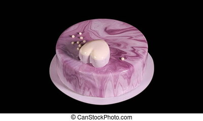 Handmade birthday cake rotating movement on a black ...