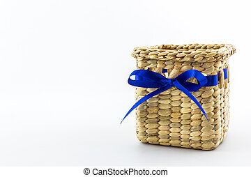 Handmade box made from dry water hyacinth on white background.