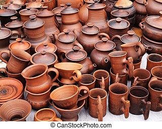 Showcase of handmade ceramic pottery in a roadside market