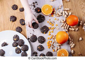 Handmade chocolate cookies with orange and cinnamon and nuts.