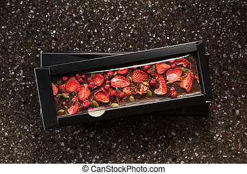 Handmade chocolate with dried strawberries, cranberry and...