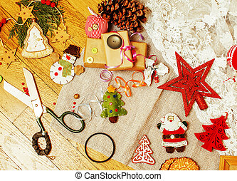 handmade christmas gifts in mess with toys, candles, fir,...