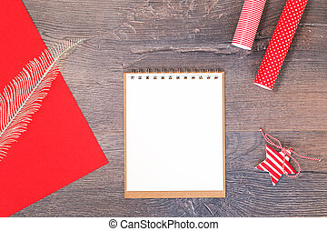 Handmade Christmas star and red gift wrapping paper and notebook