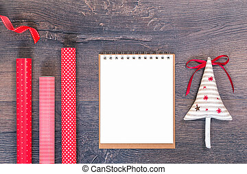 Handmade Christmas tree and red gift wrapping paper and notebook
