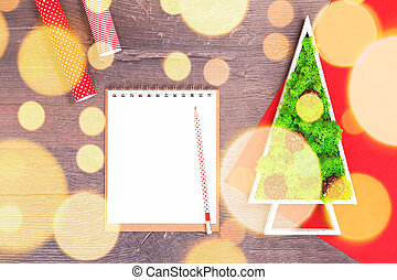 Handmade Christmas tree and red gift wrapping paper with light