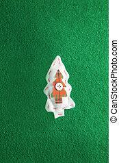 Handmade christmas tree on green background