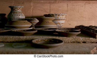 Handmade clay dishes on the table. Different clay products...