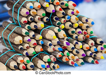 Handmade color pencil from wooden logs