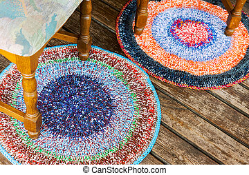 Handmade colorful rugs on a wooden floor