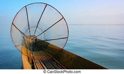 """Handmade, Conical Fishing Net on a Native Canoe in Myanmar..."