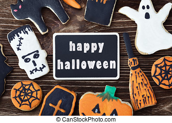handmade cookies for Halloween and the black plate for greetings. The empty space on the plate can be used for writing or drawing particular congratulations.