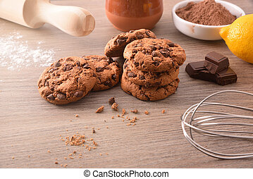 Handmade cookies with chocolate chips on wooden table elevated view