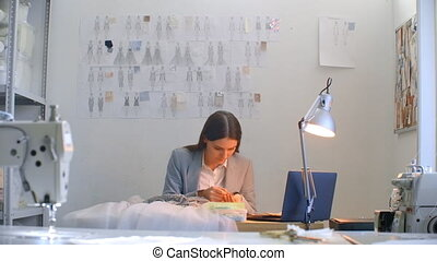 Handmade decorate the dress with crystals. Seamstress creates an exclusive dress.