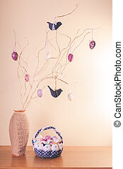 Handmade easter decorations on the branches in vase and...