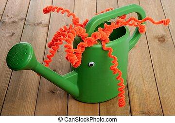 Handmade garden can toy funny face