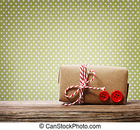 Handmade gift box over green polka dots background