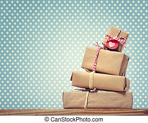 Handmade gift boxes over green polka dots background