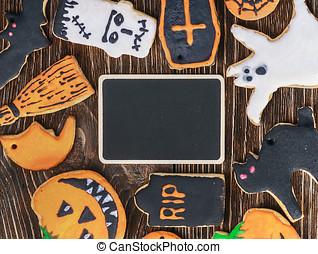 Handmade Halloween cookies on a wooden background