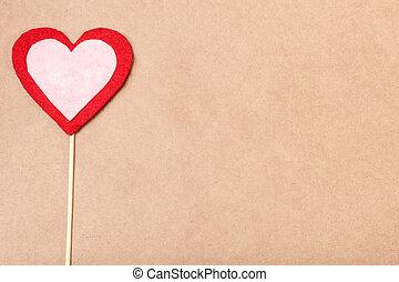 Handmade heart on papercraft