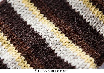 Handmade knitted pattern closeup
