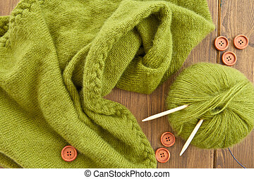 Handmade knitted scarf with green wool