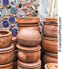 clay pottery ceramics in background broken glass debris design wall