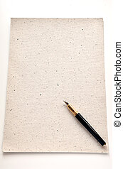 Handmade paper with a pen