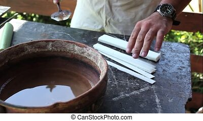 Handmade papyrus - A man working original handmade papyrus