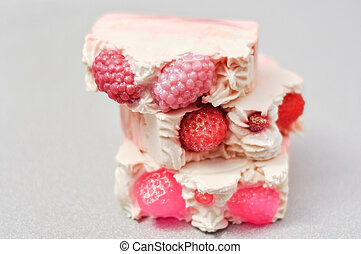 Handmade pink soap. Cold Processed Handcrafted Soap. Home made soap look like cake, ice cream with berries, glitter on gray background with sparkles. Natural homemade cosmetics and handmade soaps concept