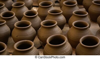 Handmade pots in India - A high angle shot of a dozen...