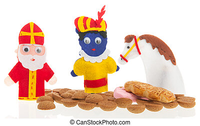 Handmade puppets and typical candy for Dutch Sinterklaas holidays