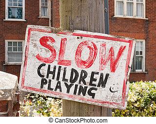 handmade sign for slowing down near children transport