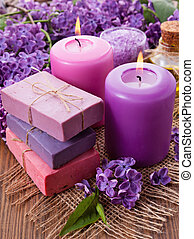 Handmade soap, candle and lilac. Spa