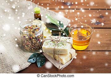 handmade soap, honey and herbal tea on wood
