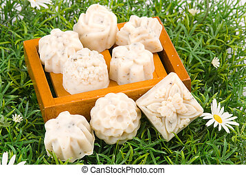 handmade soap on green grass