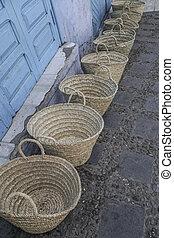 handmade straw bags at street
