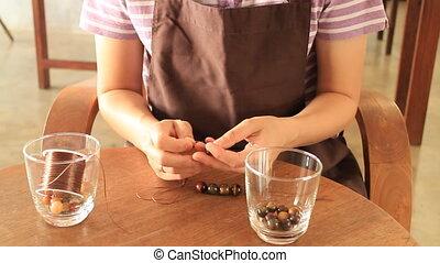 Handmade string bracelet of stone beads, Stock Video
