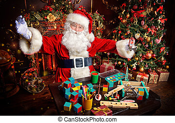 handmade toys - Workshop of Santa Claus. Portrait of Santa...