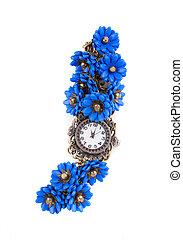 Handmade watch with blue flowers.