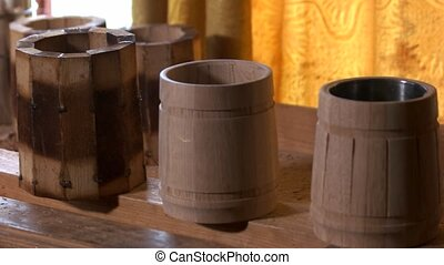 Handmade wooden beer mugs on the table.
