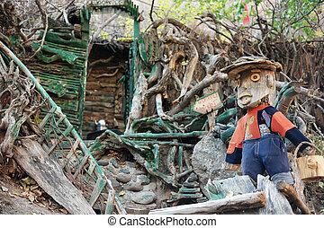 Handmade wooden figure outdoors.