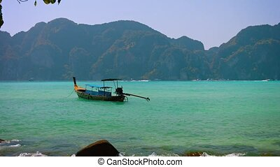 Handmade, Wooden, Longtail Boat at Anchor near a Tropical...
